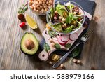 healthy green salad with... | Shutterstock . vector #588979166