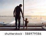 father and son standing in the...   Shutterstock . vector #588979586