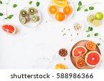 colorful fresh fruit on white... | Shutterstock . vector #588986366
