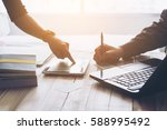 working day in office. two... | Shutterstock . vector #588995492