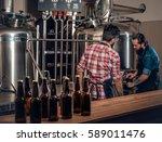two stylish bearded men brewing ... | Shutterstock . vector #589011476