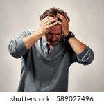Depressed Man Having A Headach...