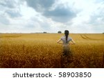 Woman Standing On A Cultivated...