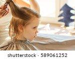 hairdresser making a hair style ...   Shutterstock . vector #589061252