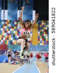 Small photo of ISTANBUL, TURKEY - DECEMBER 24, 2016: Athlete Melek Zubeyde Sahinoglu Long Jumping during Turkish Athletic Federation Indoor Athletics Record Attempt Races