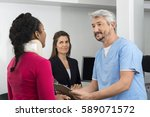 injured patient consulting... | Shutterstock . vector #589071572