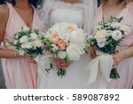 bride and bridesmaid standing... | Shutterstock . vector #589087892