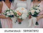 bride and bridesmaid standing... | Shutterstock . vector #589087892
