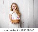 little blonde girl holding... | Shutterstock . vector #589100546