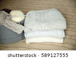 box of yarn and knitted sweaters | Shutterstock . vector #589127555