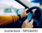 shot of a male using a mobile... | Shutterstock . vector #589186052