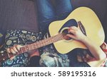 man playing on guitar | Shutterstock . vector #589195316