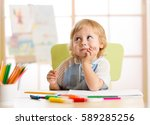 smiling kid drawing with color... | Shutterstock . vector #589285256