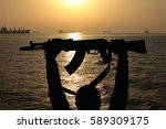 silhouette of machine gun in... | Shutterstock . vector #589309175