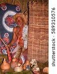 Small photo of SWAZILAND - JULY 15: Sangoma in his hut on 15 July 2000 at Swaziland. Sangoma is the shaman, healer and magicician in Swazi and Zulu culture.