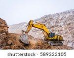 big yellow excavator | Shutterstock . vector #589322105