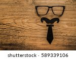 black tie and glasses lie on... | Shutterstock . vector #589339106