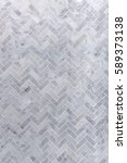 Stock photo background of grey and white marble tile in herringbone pattern 589373138