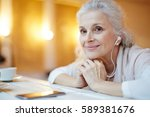 contemporary senior female with ... | Shutterstock . vector #589381676