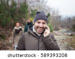 man talking on the phone outside | Shutterstock . vector #589393208