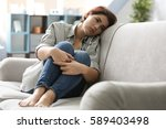 Depressed Young Woman Sitting...