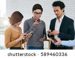 young businessman using voice... | Shutterstock . vector #589460336