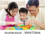 asian parent playing building... | Shutterstock . vector #589472846