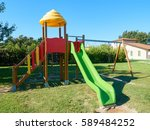 empty slide and swing at park... | Shutterstock . vector #589484252