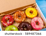 donuts with icing. sweet glazed ... | Shutterstock . vector #589487366