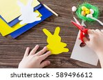 the child cuts out the details... | Shutterstock . vector #589496612
