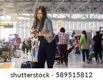 asian woman traveling by... | Shutterstock . vector #589515812