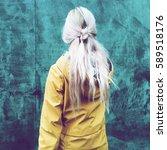 spring girl in yellow coat on...   Shutterstock . vector #589518176