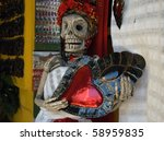 Plastic of skeleton woman - Traditional mexican souvenirs in Oaxaca City, Mexico - stock photo