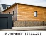 modern wooden house with stone ... | Shutterstock . vector #589611236