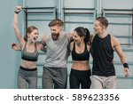 smiling sporty men and women in