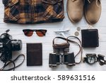 stylish men set to travel ... | Shutterstock . vector #589631516