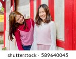 Two Asian Girls In Pink Vintag...