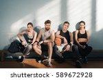 tired sporty men and women... | Shutterstock . vector #589672928