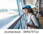 young girl at airport waiting...