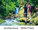 young couple hiking | Shutterstock . vector #589677662
