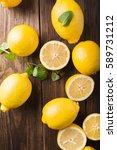 Lemons  On A Wooden Background...