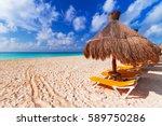 beach at caribbean sea in playa ... | Shutterstock . vector #589750286