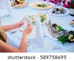 woman counts euros sitting at... | Shutterstock . vector #589758695
