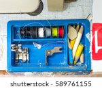thread spools and tools on desk ... | Shutterstock . vector #589761155