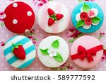 cupcakes with a summer theme | Shutterstock . vector #589777592