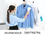 woman with steamer cleaning... | Shutterstock . vector #589798796