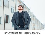 stylish man in a coat on... | Shutterstock . vector #589850792