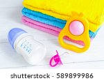 baby bottle with milk and towel ... | Shutterstock . vector #589899986