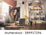 smiling businesswoman working... | Shutterstock . vector #589917296