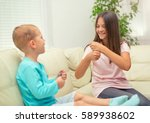 brother and sister learn sign... | Shutterstock . vector #589938602